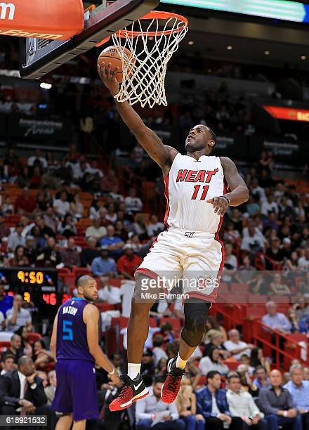 Dion Waiters of the Miami Heat drives to the basket during a game against the Charlotte Hornets at American Airlines Arena on October 28 2016 in...