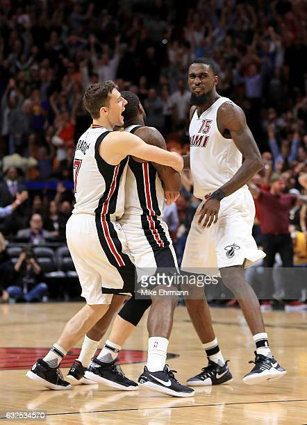 Dion Waiters of the Miami Heat is congratulated by Goran Dragic during a game against the Golden State Warriors at American Airlines Arena on January...