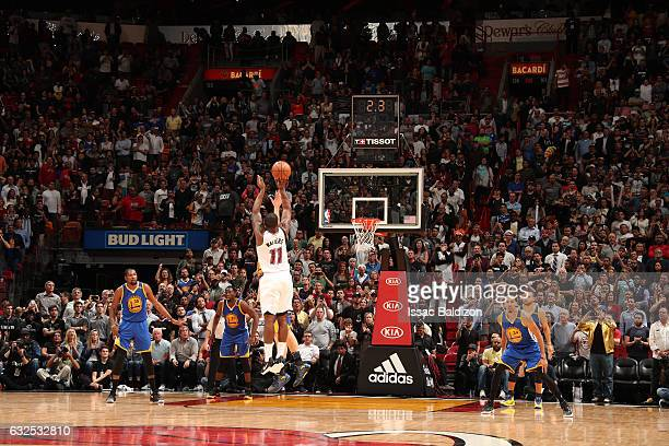 Dion Waiters of the Miami Heat shoots the game winning shot during the game against the Golden State Warriors on January 23 2017 at American Airlines...