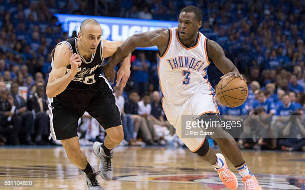 Dion Waiters of the Oklahoma City Thunder drives around Manu Ginobili of the San Antonio Spurs during the first half ofGame Six of the Western...