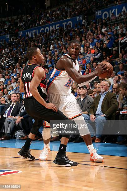 Dion Waiters of the Oklahoma City Thunder handles the ball against Tim Frazier of the Portland Trail Blazers on April 13 2015 at Chesapeake Energy...