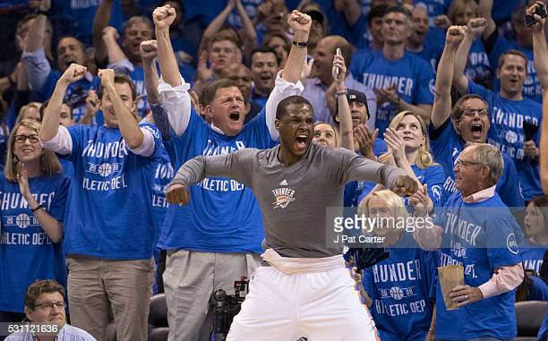 Dion Waiters of the Oklahoma City Thunder reacts as the Thunder lead over the San Antonio Spurs grows during the second half of Game Six of the...