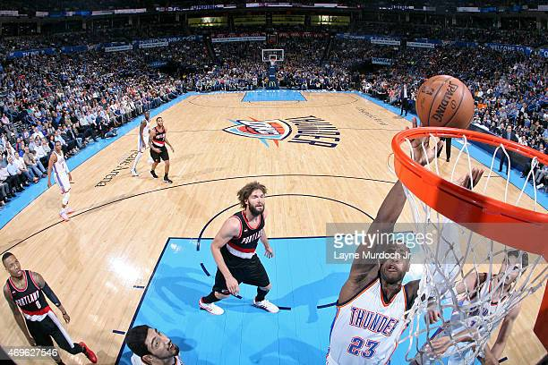Dion Waiters of the Oklahoma City Thunder shoots against the Portland Trail Blazers on April 13 2015 at Chesapeake Energy Arena in Oklahoma City...