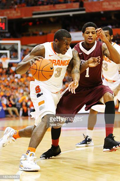 Dion Waiters of the Syracuse Orange drives around Brandon Frazier of the Fordham University Rams during the game at the Carrier Dome on November 12...