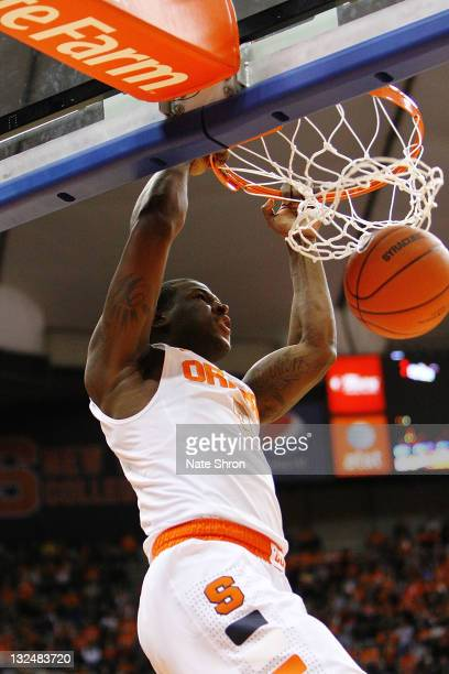Dion Waiters of the Syracuse Orange dunks during the game against the Fordham University Rams at the Carrier Dome on November 12 2011 in Syracuse New...
