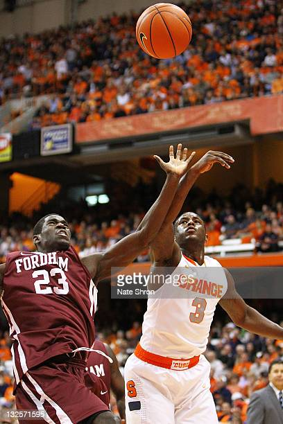 Dion Waiters of the Syracuse Orange fights for the ball against Marvin Dominique of the Fordham University Rams during the game at the Carrier Dome...