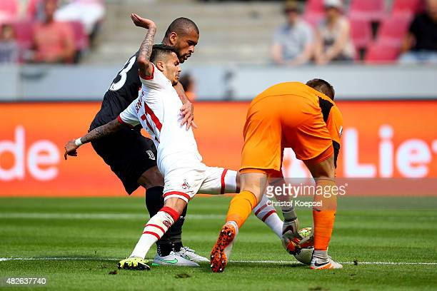 Dionatan Teixeira of Stoke City and Jack Butlan of Stoke City challenge Leonardo Bittencourt of Koeln during the Colonia Cup 2015 match between 1 FC...