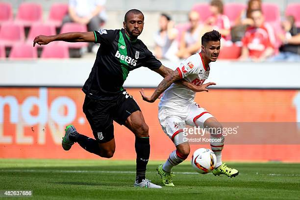 Dionatan Teixeira of Stoke City challenges Leonardo Bittencourt of Koeln during the Colonia Cup 2015 match between 1 FC Koeln and Stoke City FC at...