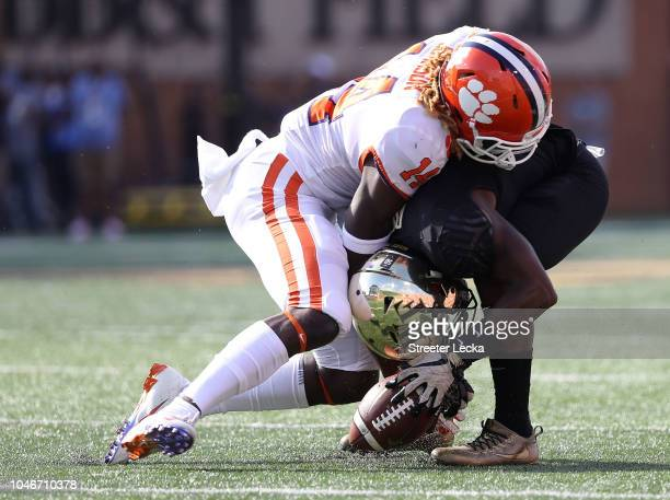 Diondre Overton of the Clemson Tigers tackles Greg Dortch of the Wake Forest Demon Deacons during their game at BBT Field on October 6 2018 in...