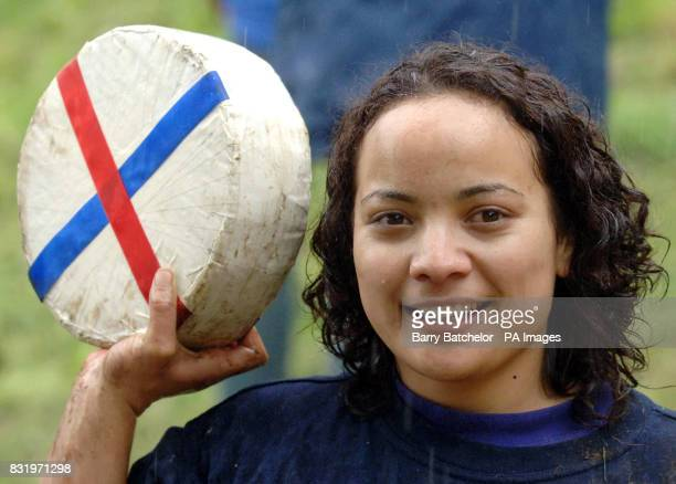 Dione Carter from Auckland New Zealand holds her prize after winning the women's race for the third year running at the annual giant cheesechase at...