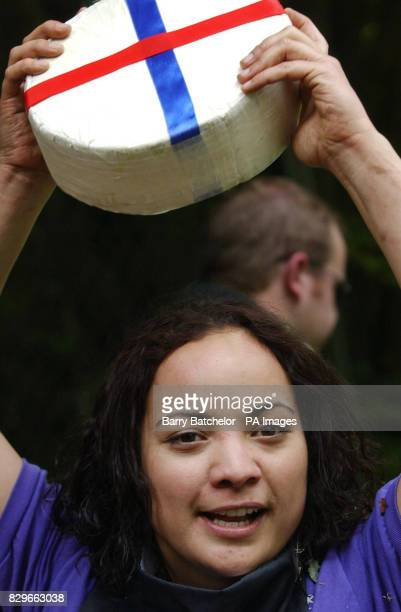 Dione Carter holds aloft the Double Gloucester cheese her prize for winning the woman's event in the ancient daredevil sport Dione Carter originally...