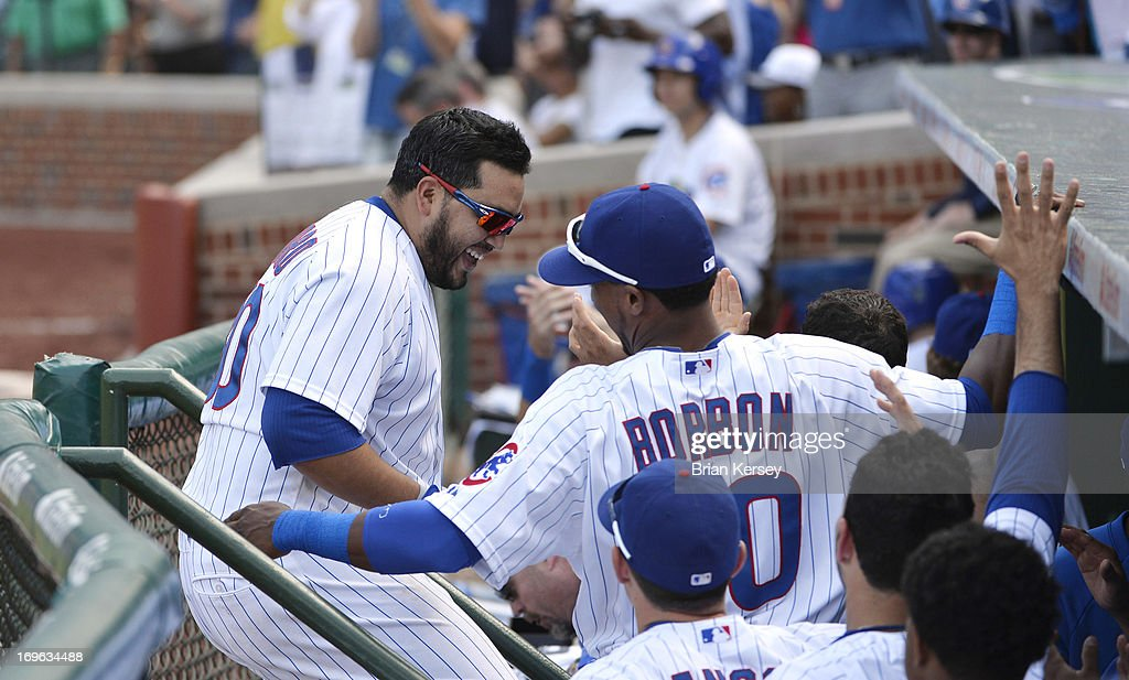 Dioner Navarro #30 of the Chicago Cubs celebrates with his teammates after hitting a three-run home run scoring teammates Alfonso Soriano #12 and Anthony Rizzo #44 during the seventh inning against the Chicago White Sox at Wrigley Field on May 29, 2013 in Chicago, Illinois. The home run was Navarro's third of the game.