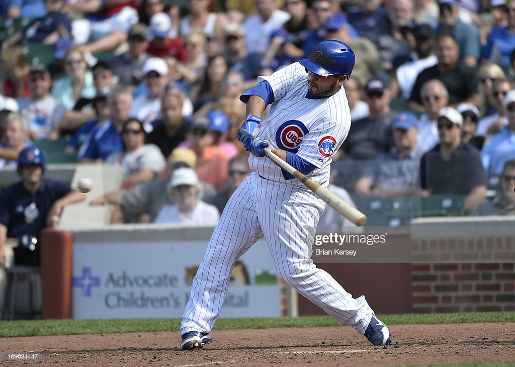 Dioner Navarro #30 of the Chicago Cubs connects on a three-run home run scoring teammates Alfonso Soriano #12 and Anthony Rizzo #44 during the seventh inning against the Chicago White Sox at Wrigley Field on May 29, 2013 in Chicago, Illinois.