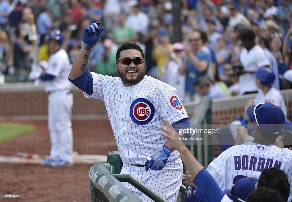 Dioner Navarro #30 of the Chicago Cubs takes a curtain call after hitting a three-run home scoring teammates Alfonso Soriano #12 and Anthony Rizzo #44 during the seventh inning at Wrigley Field on May 29, 2013 in Chicago, Illinois. The home run was his third of the game.