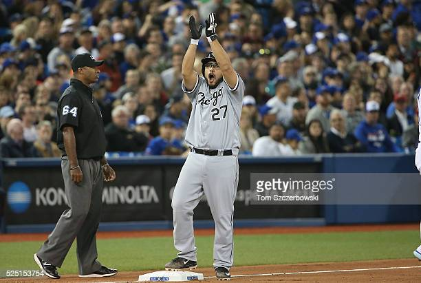 Dioner Navarro of the Chicago White Sox celebrates after hitting a tworun triple in the seventh inning during MLB game action against the Toronto...