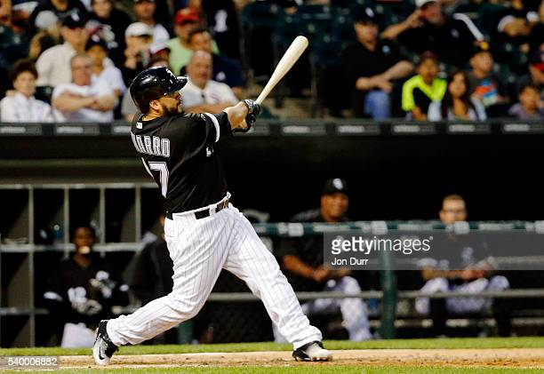 Dioner Navarro of the Chicago White Sox hits a one run home run against the Detroit Tigers during the fourth inning at US Cellular Field on June 13...