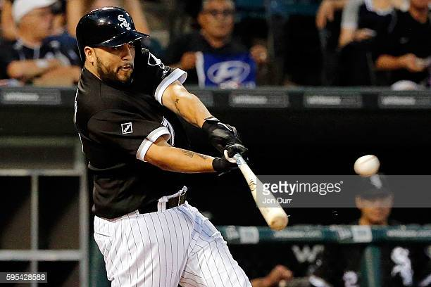 Dioner Navarro of the Chicago White Sox hits a sacrifice fly against the Seattle Mariners to score Jose Abreu during the first inning at US Cellular...