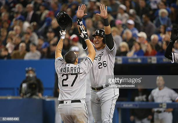 Dioner Navarro of the Chicago White Sox is congratulated by Avisail Garcia after hitting a tworun home run in the seventh inning during MLB game...