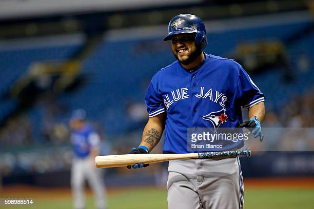 Dioner Navarro of the Toronto Blue Jays reacts after striking out swinging to end the top of the fourth inning of a game against the Tampa Bay Rays...