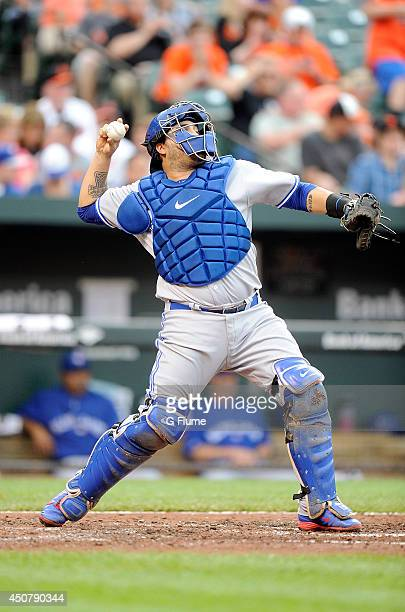 Dioner Navarro of the Toronto Blue Jays throws the ball to seecond base against the Baltimore Orioles at Oriole Park at Camden Yards on June 13 2014...