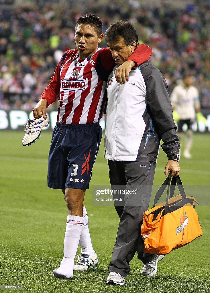 Dionicio Escalante #3 of Chivas de Guadalajara is helped off the field after an suffering an injury against the Seattle Sounders FC on October 12, 2010 at Qwest Field in Seattle, Washington. The Sounders defeated Chivas de Guadalajara 3-1.