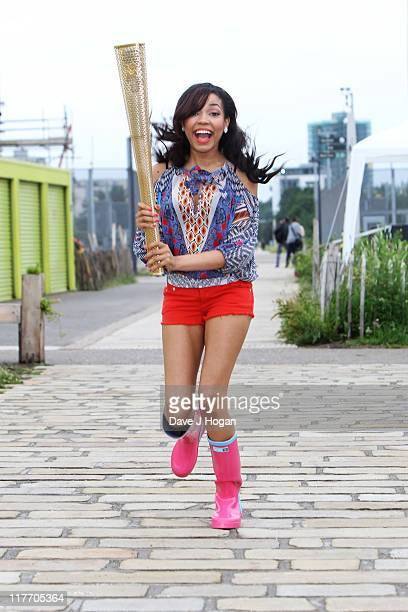 Dionne Bromfield poses with the official Olympic Relay Torch to announce she will be will be releasing the official Olympic torch relay song...