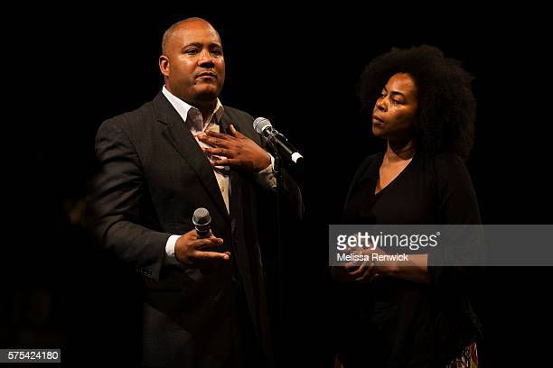 Dionne Renee listens to Minister Michael Coteau answer her question during an anti-racism meeting at Daniel's Spectrum with Premier Kathleen Wynne...