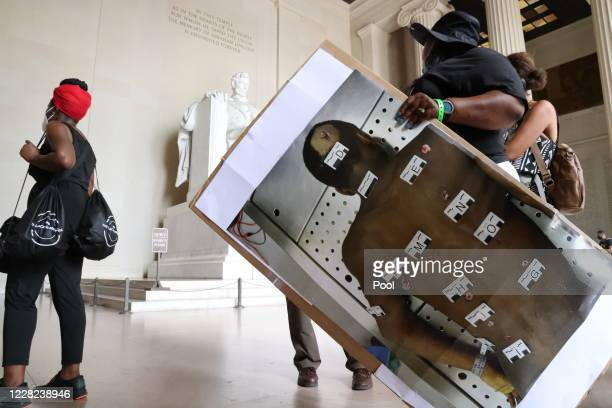 Dionne Smith mother of James Rivera who was shot and killed by Stockton California police officers on July 22 carries an autopsy photograph of Rivera...