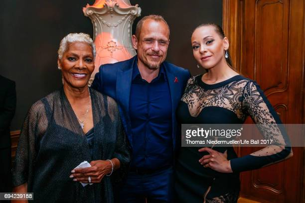 Dionne Warwick Life Ball organizer Gery Keszler and Cheyenne Elliott attend the Life Ball 2017 reception at Palais Szechenyi on June 9 2017 in Vienna...