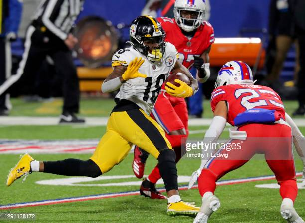 Diontae Johnson of the Pittsburgh Steelers carries the ball against the Buffalo Bills during the fourth quarter in the game at Bills Stadium on...