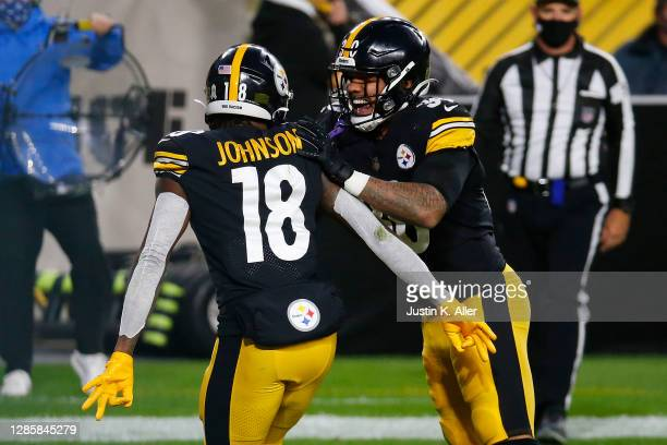 Diontae Johnson of the Pittsburgh Steelers celebrates a 12-yard touchdown against the Cincinnati Bengals with James Conner during their NFL game at...