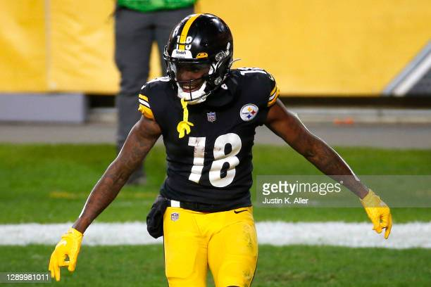 Diontae Johnson of the Pittsburgh Steelers celebrates following a touchdown reception during the first half of their game against the Washington...