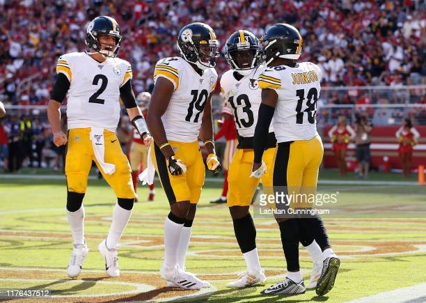 Diontae Johnson of the Pittsburgh Steelers celebrates with James Washington JuJu SmithSchuster and Mason Rudolph after scoring a touchdown in the...