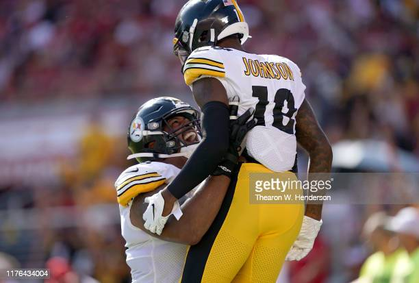 Diontae Johnson of the Pittsburgh Steelers is lifted up by Ramon Foster after scoring a touchdown in the fourth quarter against the San Francisco...