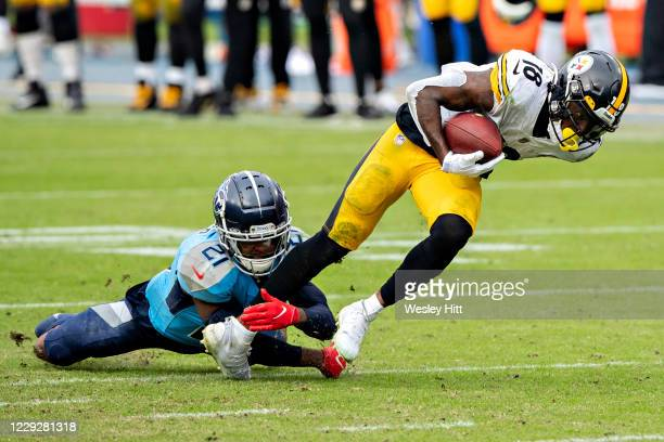 Diontae Johnson of the Pittsburgh Steelers is tackled in the second half after catching a pass by Malcolm Butler of the Tennessee Titans at Nissan...