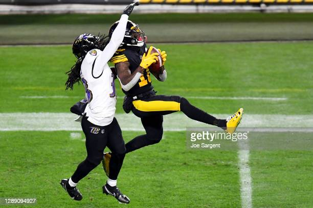 Diontae Johnson of the Pittsburgh Steelers makes a reception over Davontae Harris of the Baltimore Ravens during the fourth quarter at Heinz Field on...