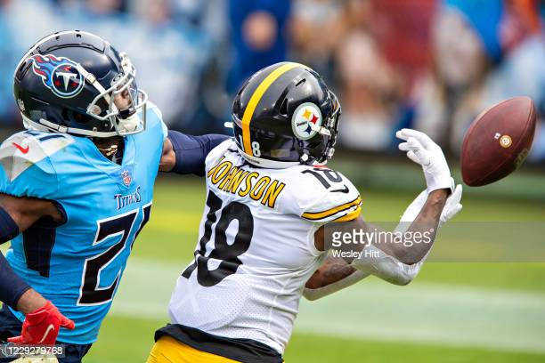 Diontae Johnson of the Pittsburgh Steelers misses a pass in the first half while being defended by Malcolm Butler of the Tennessee Titans at Nissan...