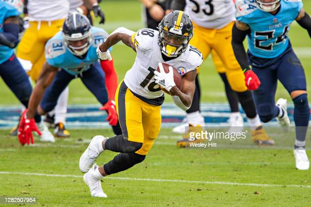 Diontae Johnson of the Pittsburgh Steelers runs the ball after catching a pass during a game against the Tennessee Titans at Nissan Stadium on...