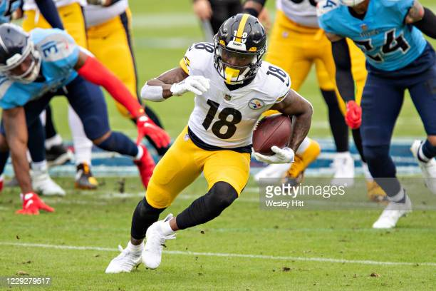 Diontae Johnson of the Pittsburgh Steelers runs the ball after catching a pass in the first half of a game against the Tennessee Titans at Nissan...