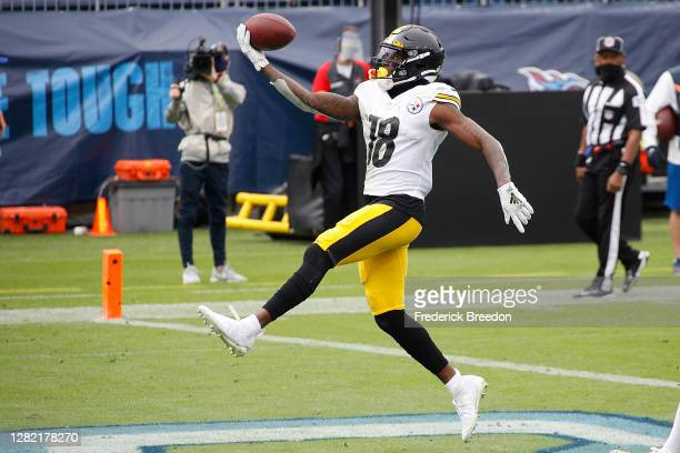 Diontae Johnson of the Pittsburgh Steelers scores a touchdown against the Tennessee Titans during the first half at Nissan Stadium on October 25,...
