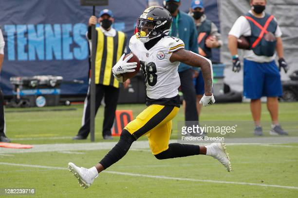 Diontae Johnson of the Pittsburgh Steelers scores a touchdown against the Tennessee Titans at Nissan Stadium on October 25, 2020 in Nashville,...