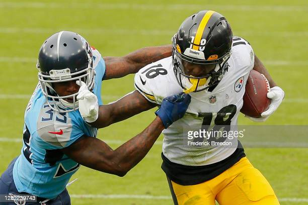 Diontae Johnson of the Pittsburgh Steelers stiff arms Johnathan Joseph of the Tennessee Titans at Nissan Stadium on October 25, 2020 in Nashville,...