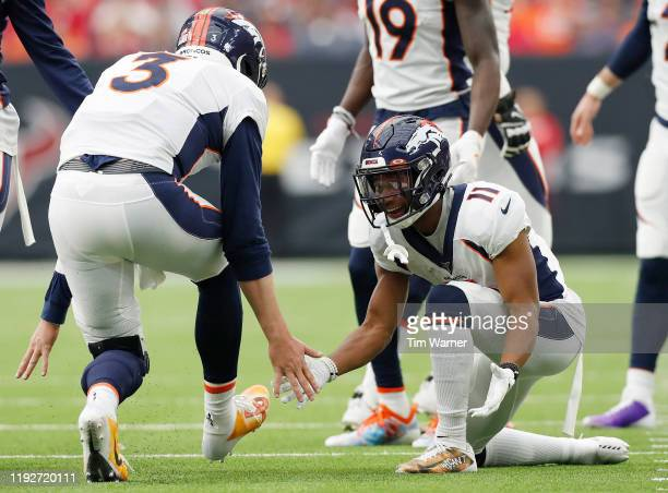 Diontae Spencer of the Denver Broncos celebrates with teammate Drew Lock of the Denver Broncos after Lock threw a pass for a touchdown in the second...