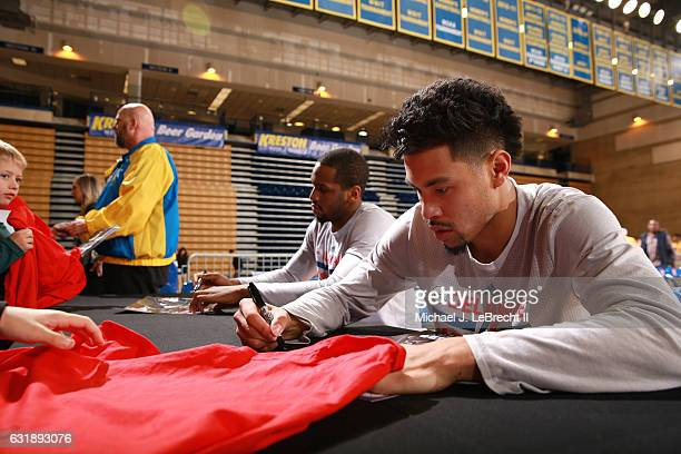 Dionte Christmas and Mikh McKinney of the Delaware 87ers sign autographs after the game against the Erie BayHawks on January 6 2017 at the Bob...