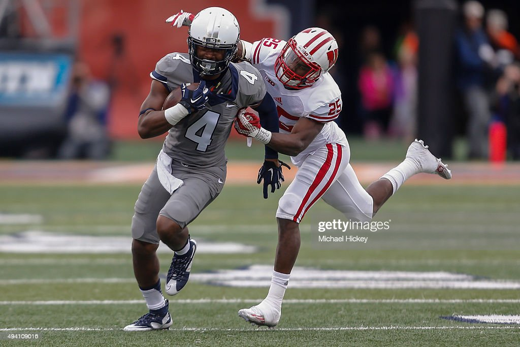 Dionte Taylor #4 of the Illinois Fighting Illini runs the ball as Derrick Tindal #25 of the Wisconsin Badgers tries to make the tackle at Memorial Stadium on October 24, 2015 in Champaign, Illinois. Wisconsin defeated Illinois 24-13.