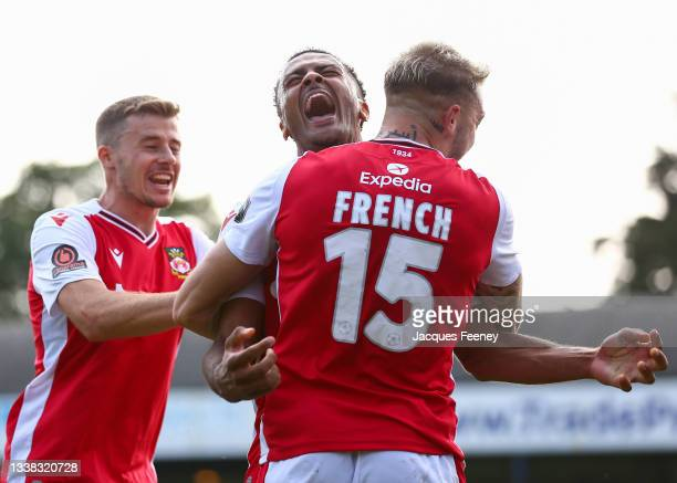 Dior Angus of Wrexham celebrates after scoring their team's second goal with Tyler French of Wrexham during the Vanarama National League match...