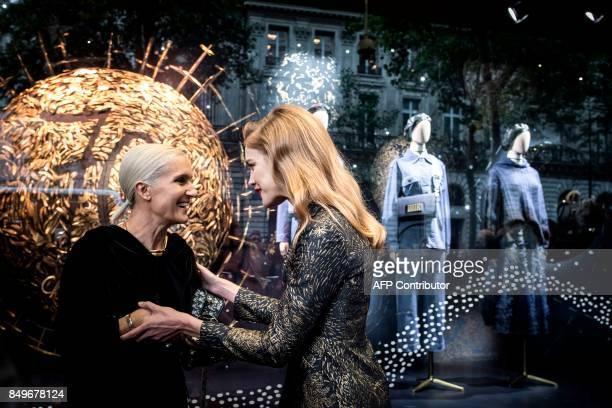 Dior artistic director Maria Grazia Chiuri chats with Russian model Natalia Vodianova before the opening of an exhibition to celebrate the 70th...