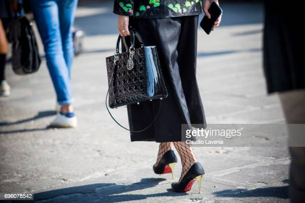 Dior bad and Christian Louboutin shoes are seen during Pitti Immagine Uomo 92 at Fortezza Da Basso on June 14 2017 in Florence Italy