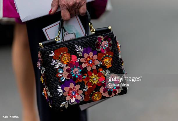 Dior bag outside Chanel during Paris Fashion Week Haute Couture F/W 2016/2017 on July 5 2016 in Paris France