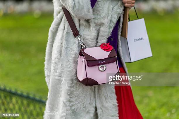 A Dior bag outside Chanel during the Paris Fashion Week Haute Couture Spring/Summer 2016 on January 26 2016 in Paris France